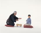 将棋を指す祖父と孫