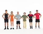 腰に手を当てスポーツウェアを着る人々